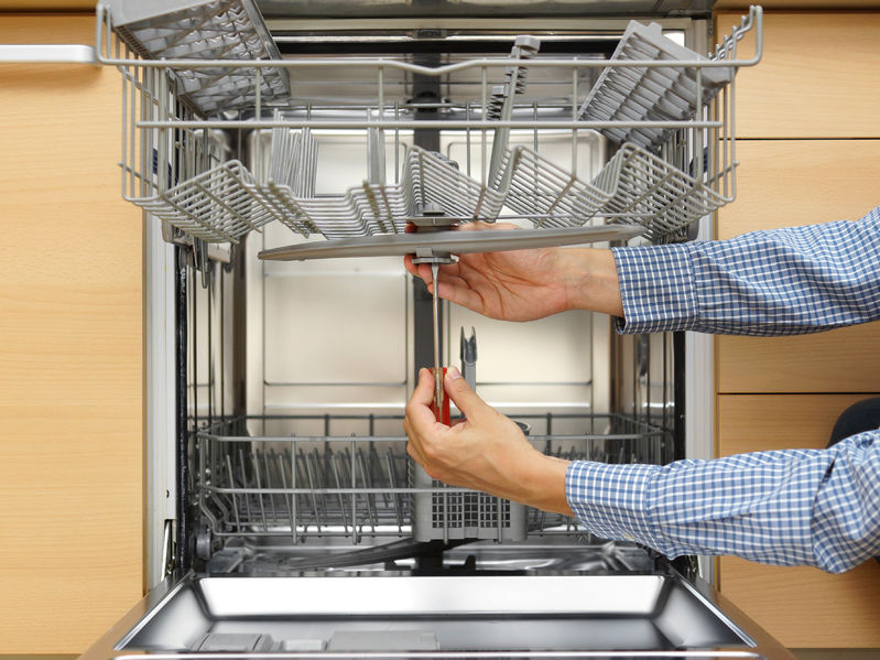 31038838 - handyman repairing a dishwasher