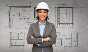 29244552 - building, developing, construction and architecture concept - smiling businesswoman in white helmet with crossed arms